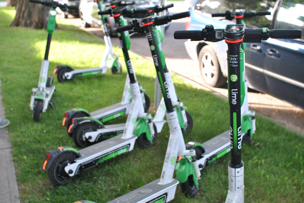 grey-black-and-green kick scooters