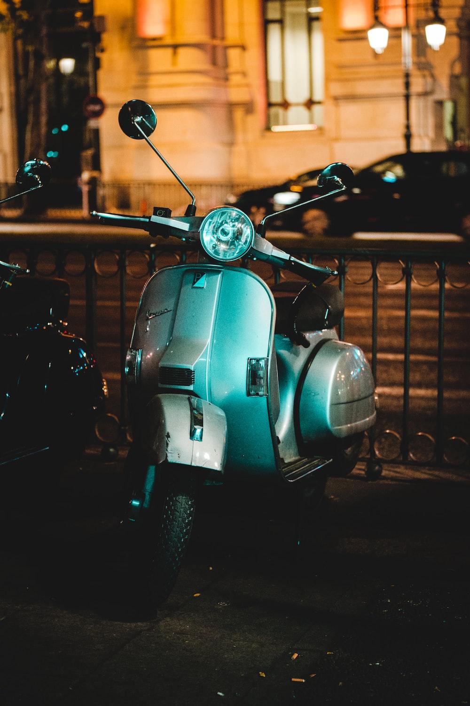 grey motor scooter at night