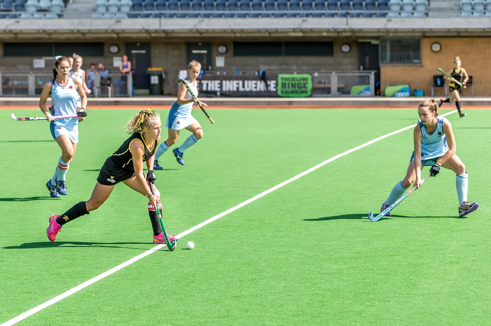 woman wearing black jersey playing on field