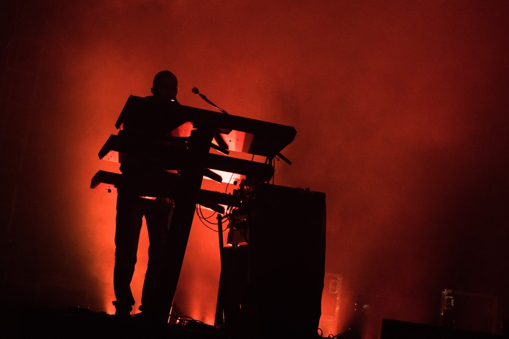 silhouette of man performing on stage