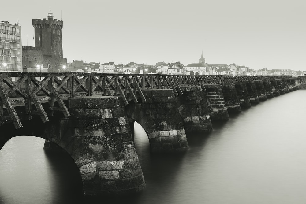 selective focus photography of concrete bridge