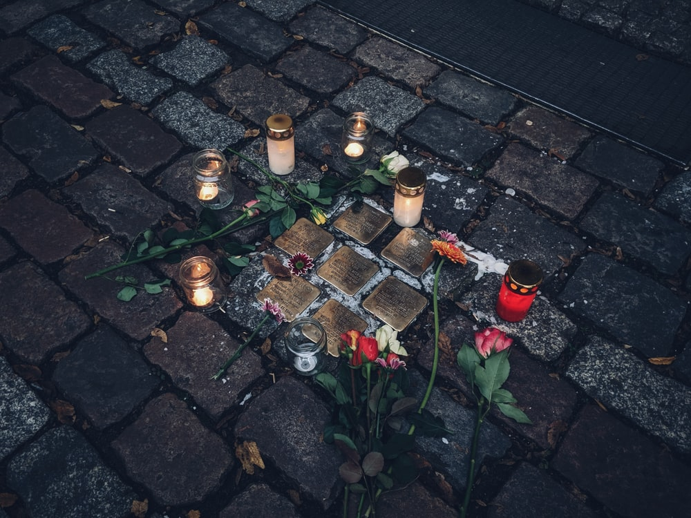 lit candles on ground