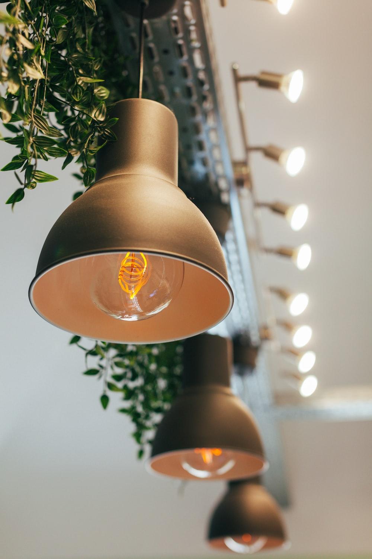 gray pendant lamp beside vanity lamp
