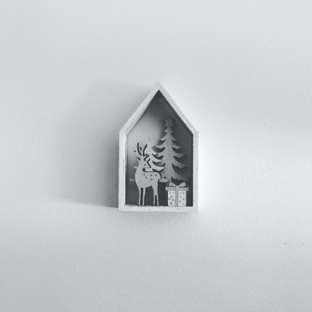 white wooden deer wall decor