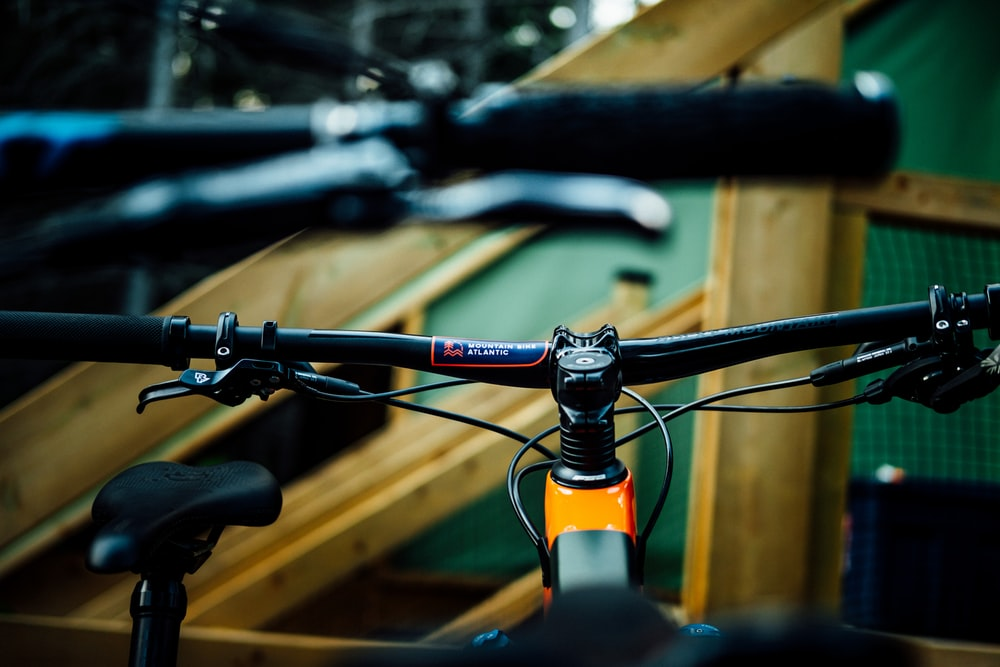 black and orange mountain bike