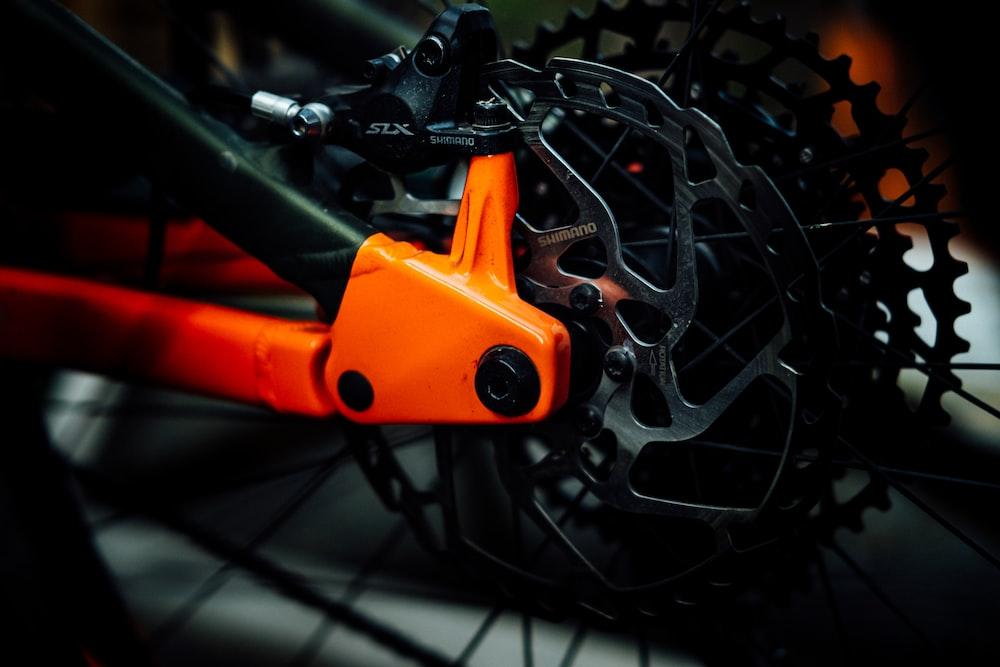 black and orange bike gear s