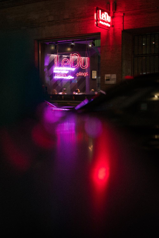 Le Du neon light signage of a store