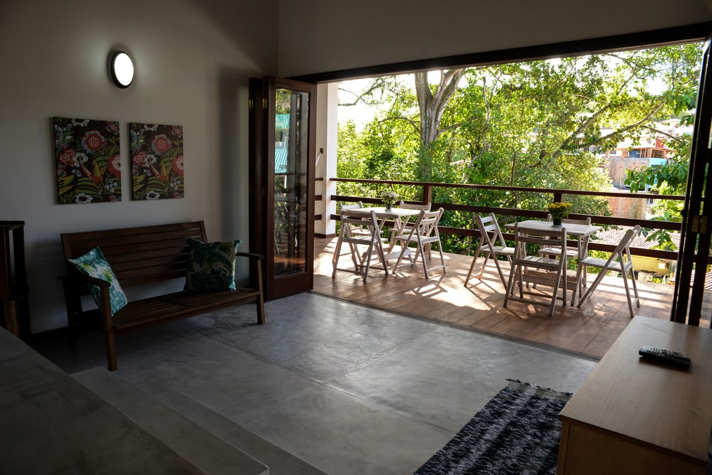 brown wooden dining table on balcony
