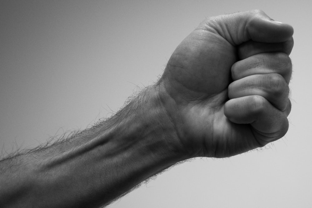 person showing left fist