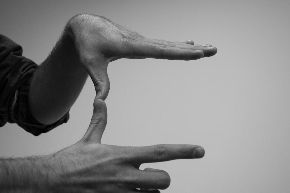 human hands forming a U