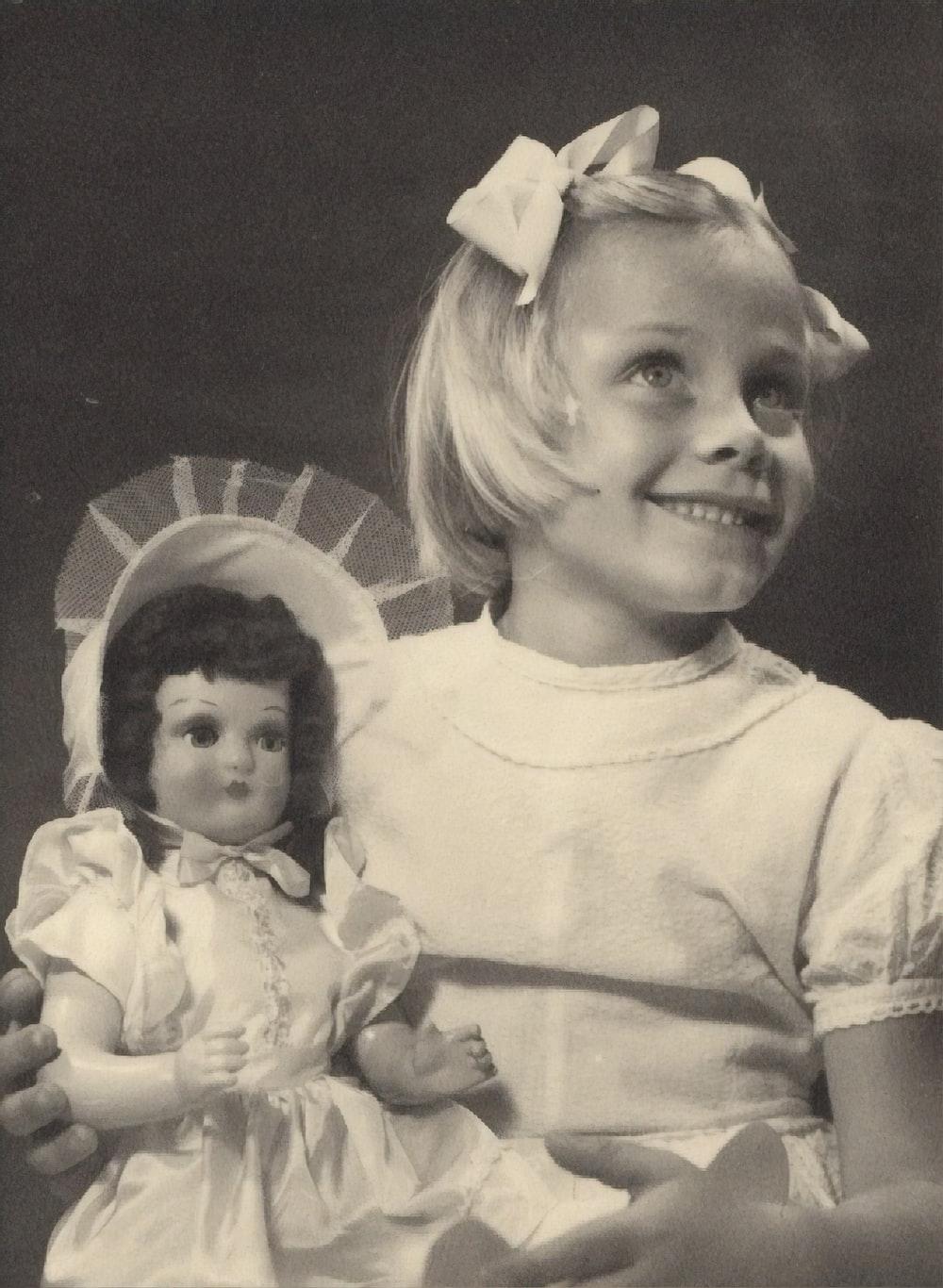girl holding doll
