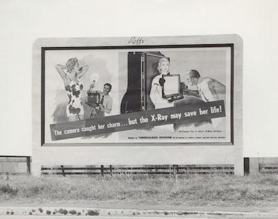 billboard beside grass field