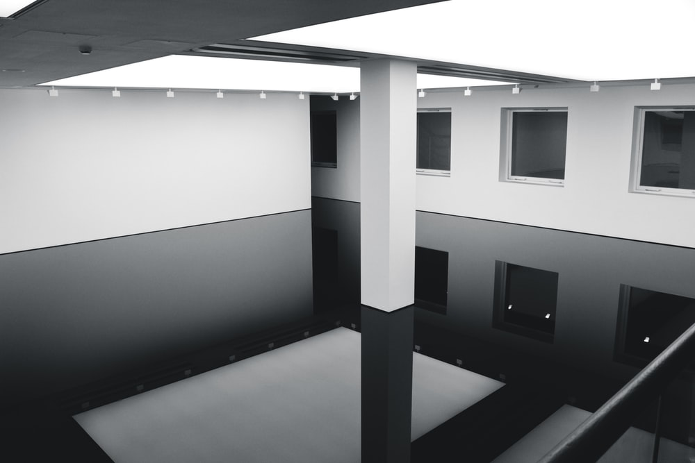 grayscale photography of inside building view