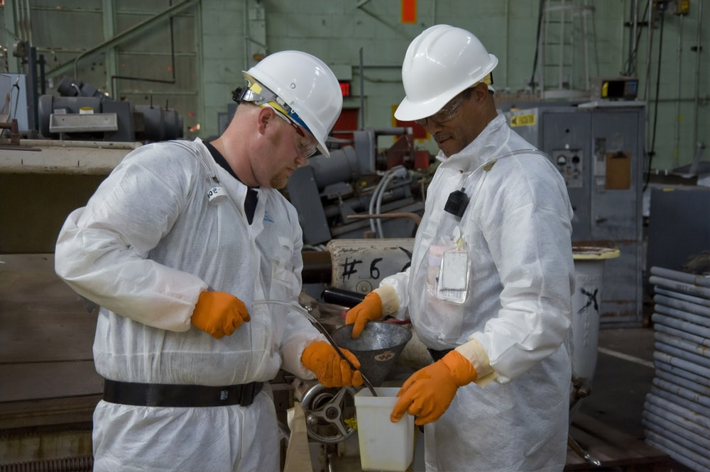scientists wearing white hard hats