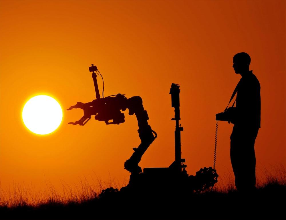 man controlling robot