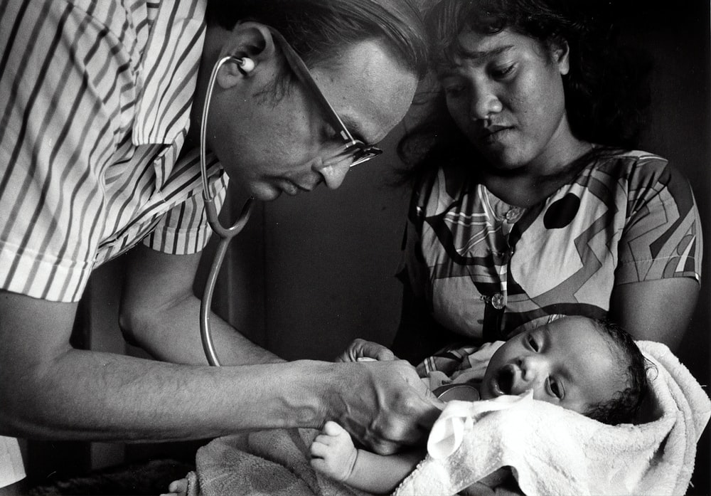 doctor checking baby