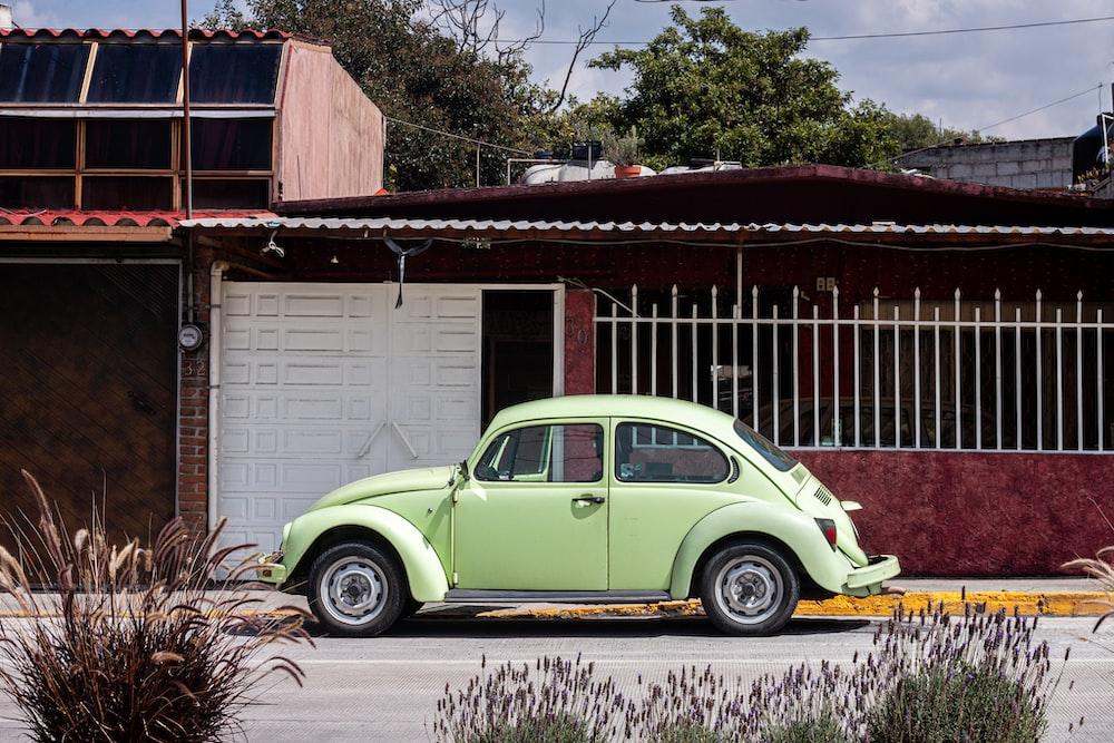 green Volkswagen Beetle 3-door hatchback