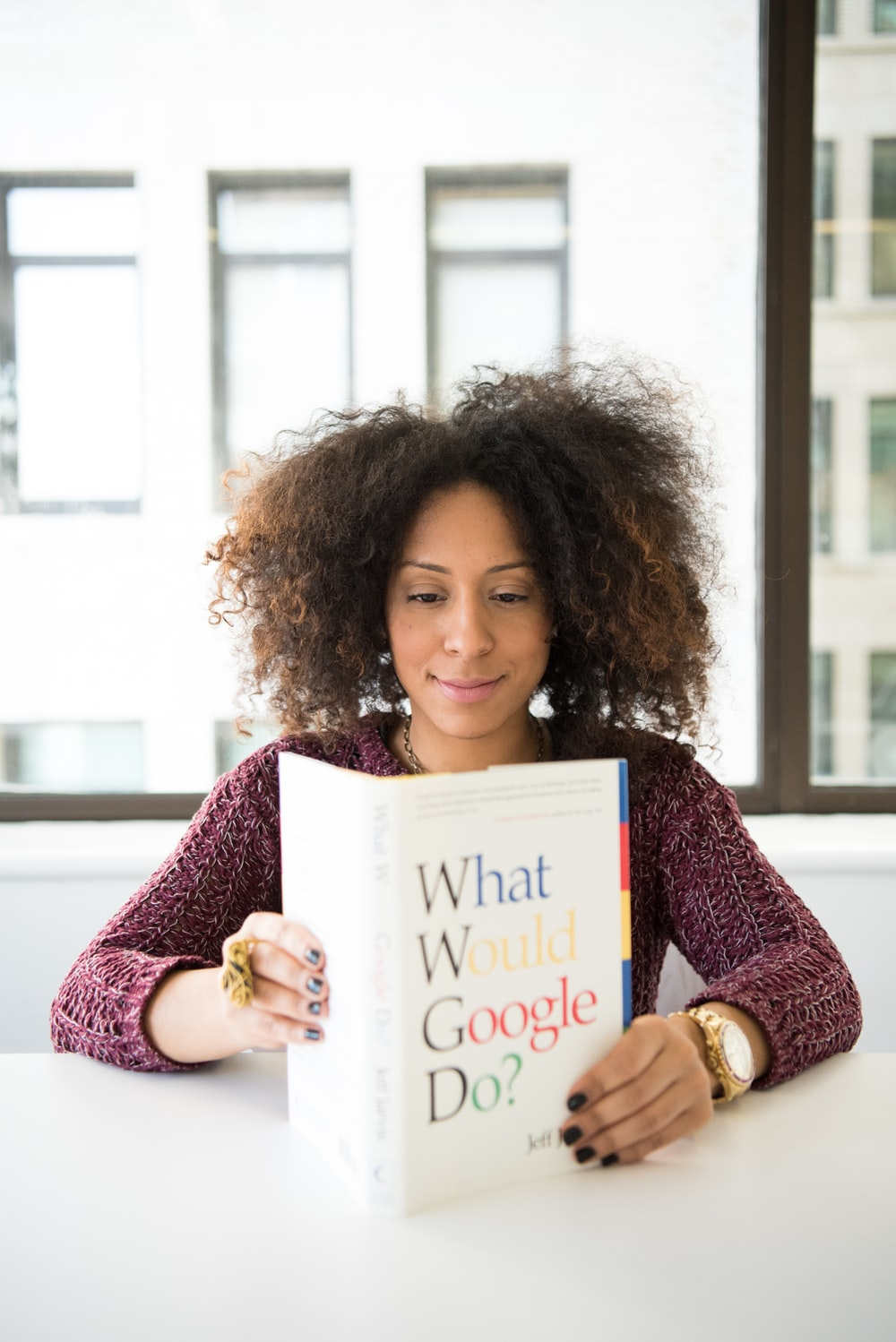 woman reading What Would Google Do? book