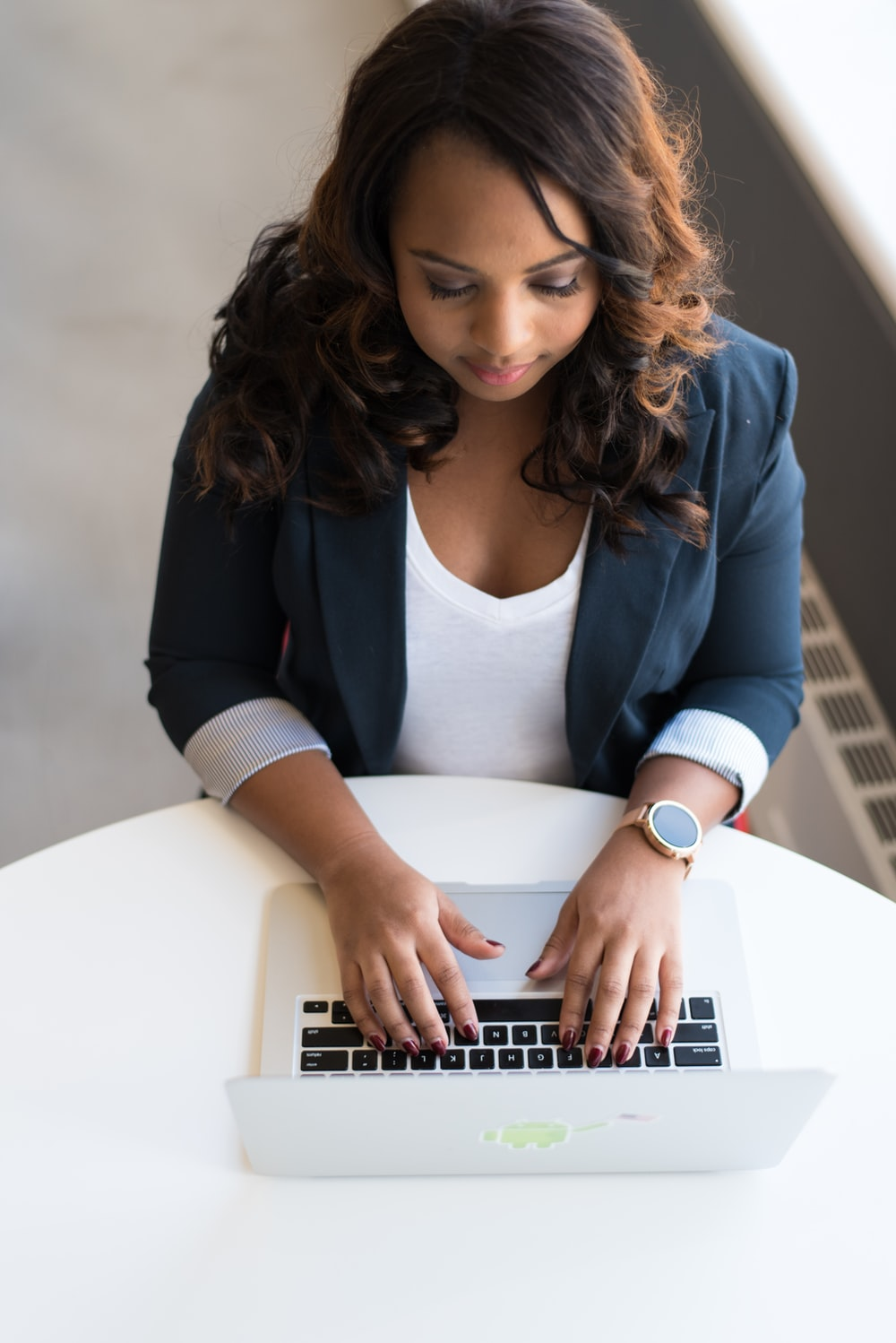 woman using MacBook laptop on table