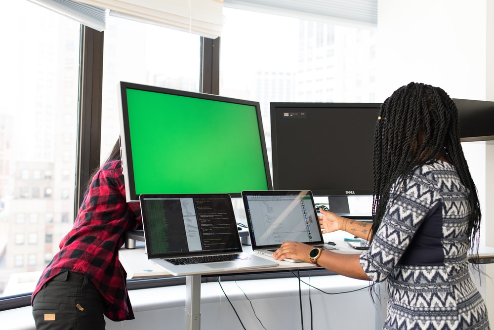 shallow focus photo of woman using laptop computer