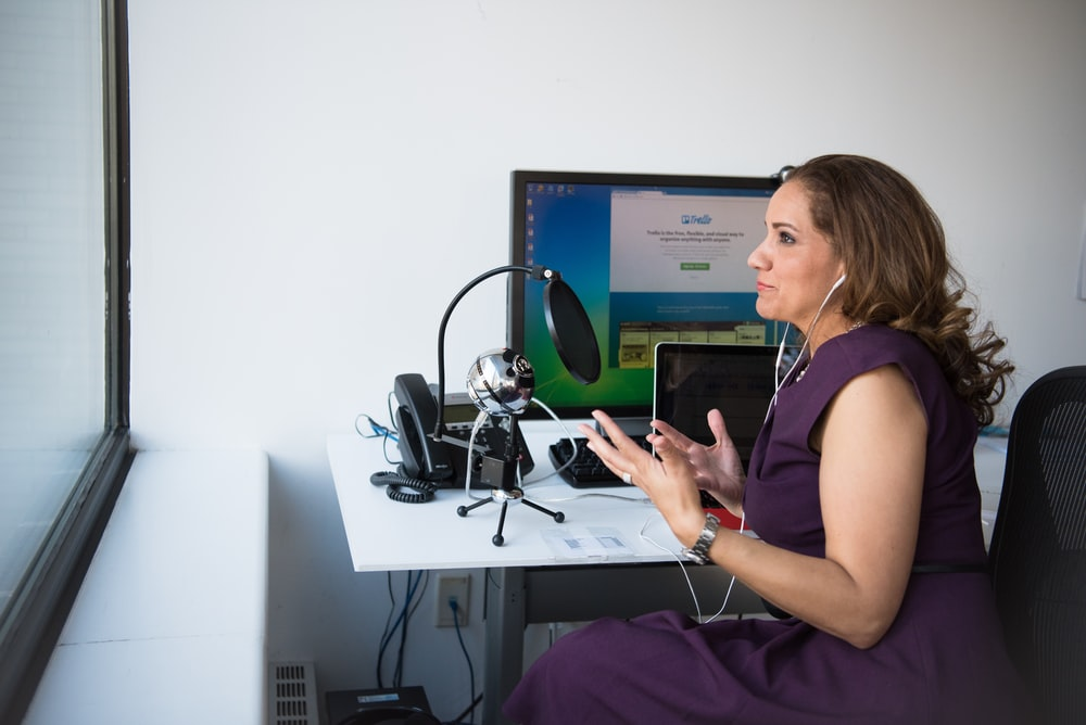 woman facing microphone