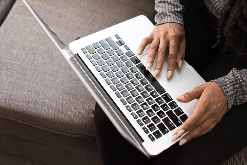 woman facing MacBook