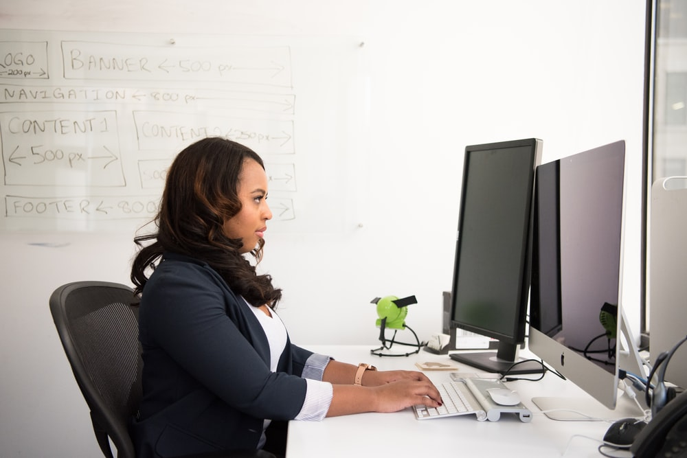 woman sitting infront of monitor