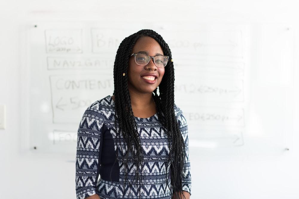 smiling woman wearing chevron top