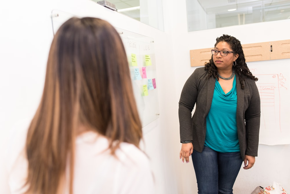 woman looking at whiteboard