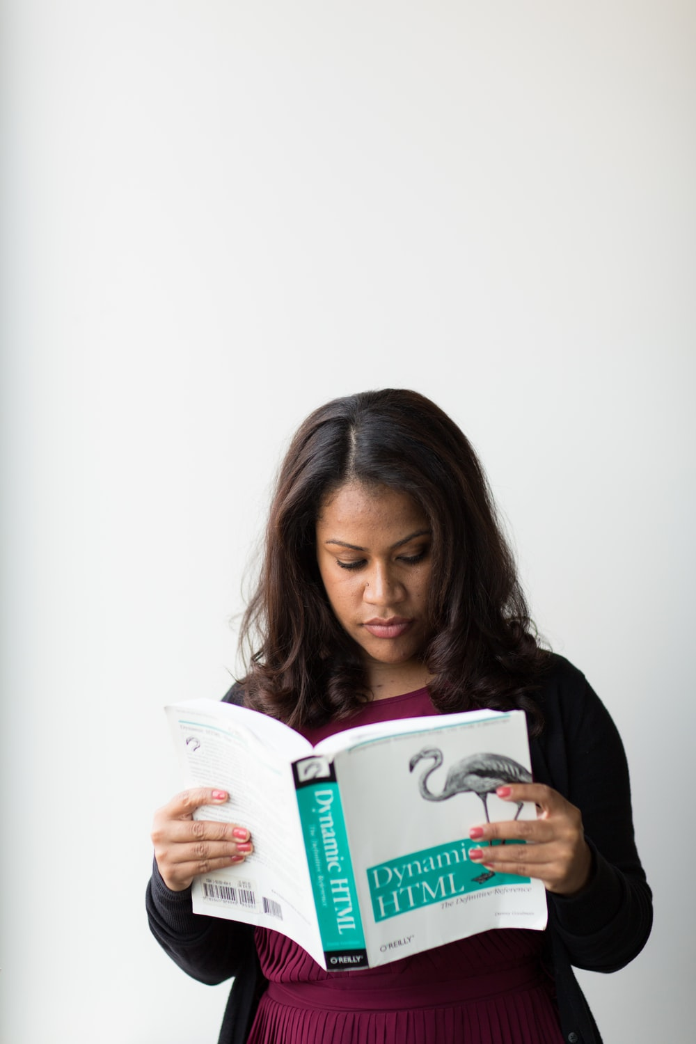 standing woman reading Dynamic HTML book