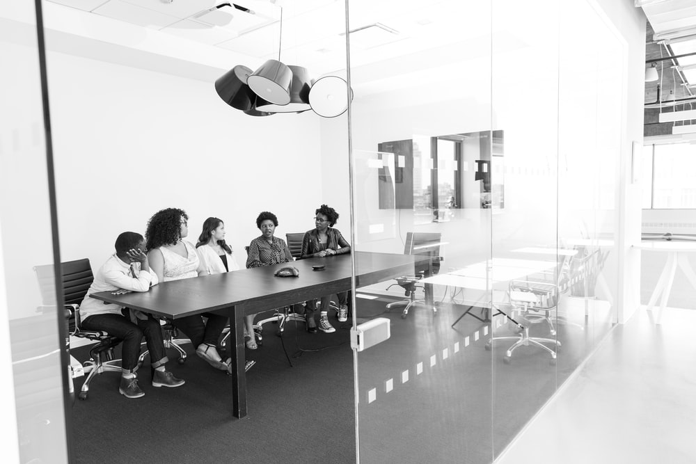 grayscale photo of people in room