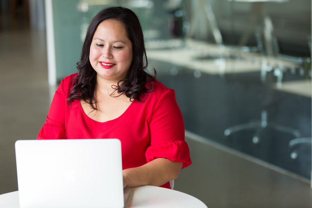 selective focus photography of woman using laptop computer