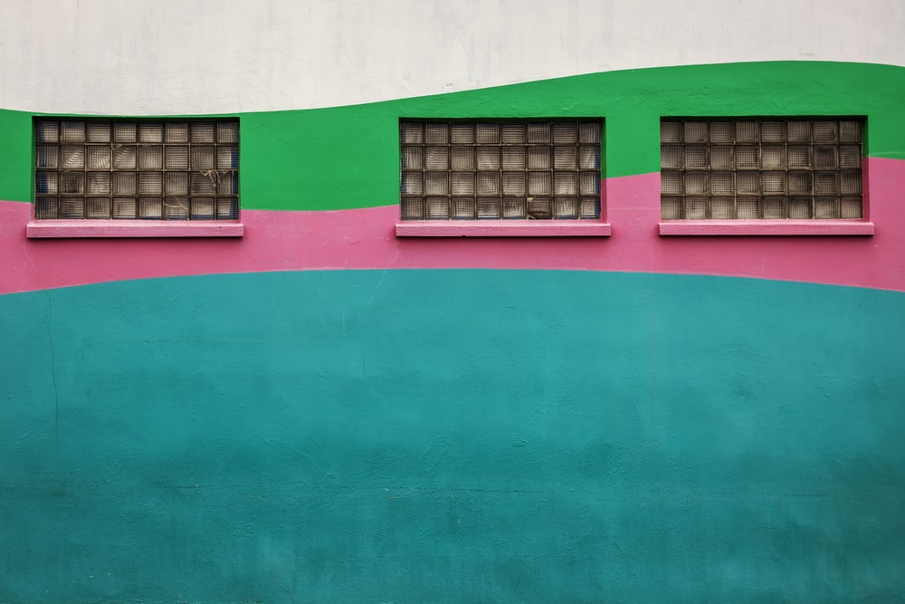teal, pink, and green wall