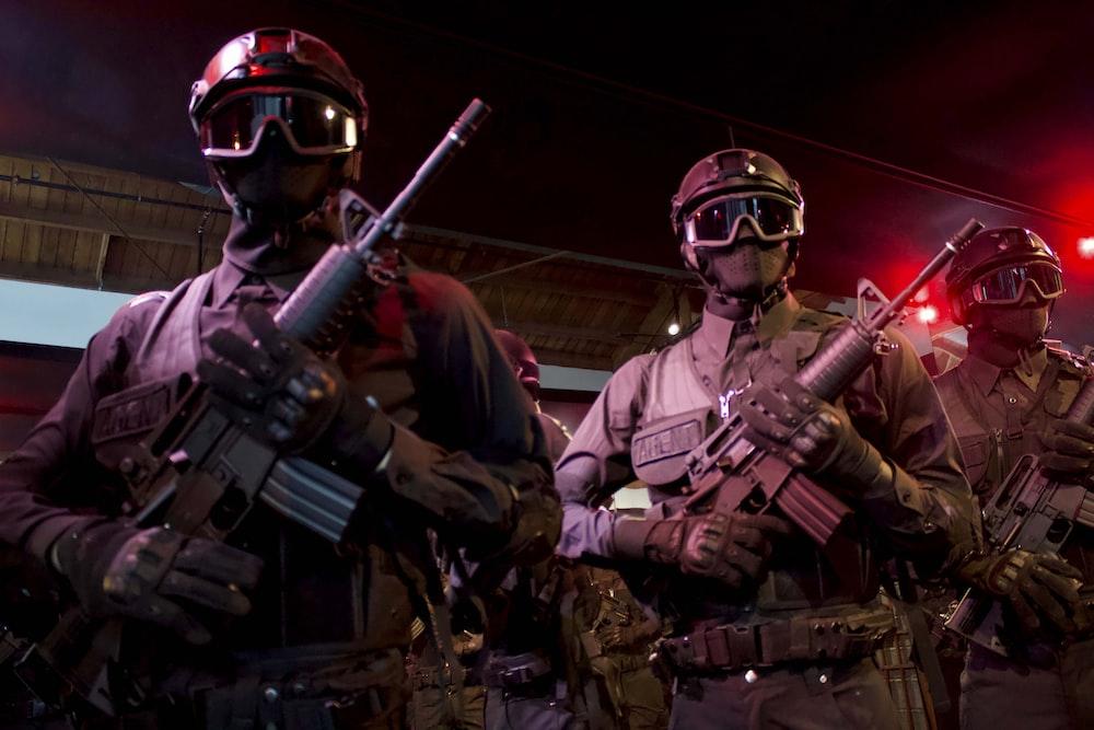 men with assault rifles