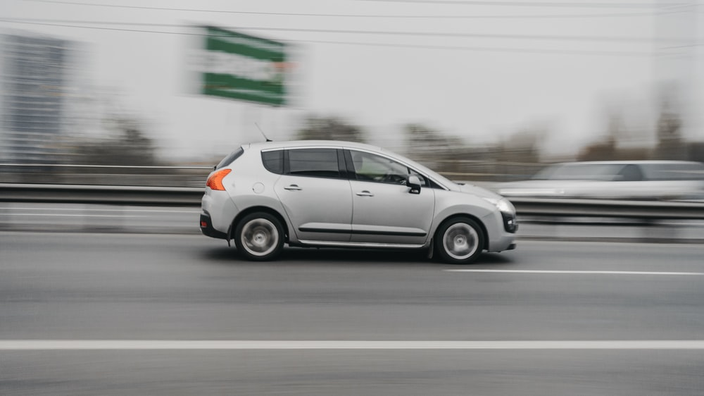 panning photography of 5-door hatchback