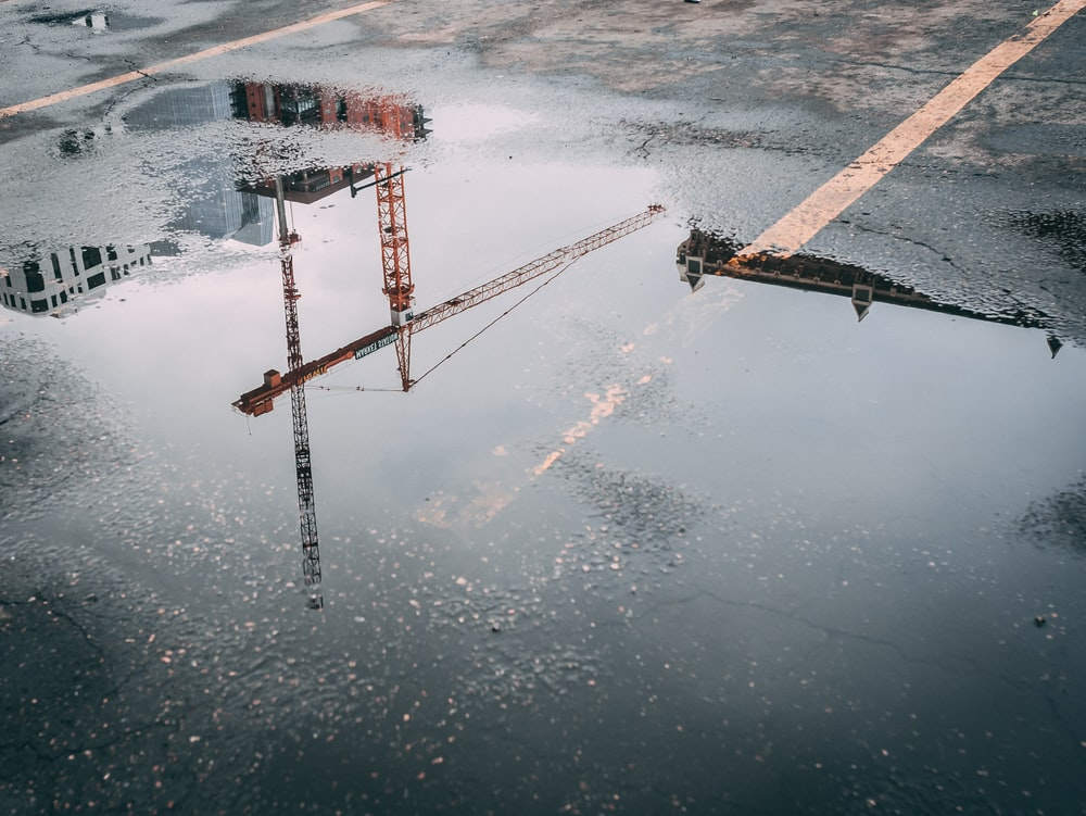 tower crane reflecting on water