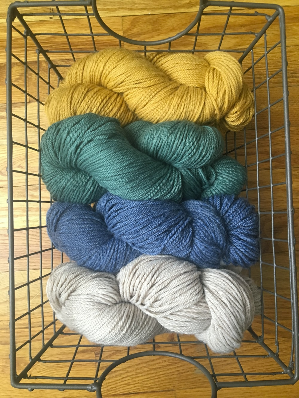 yellow, green, blue, and white yarn