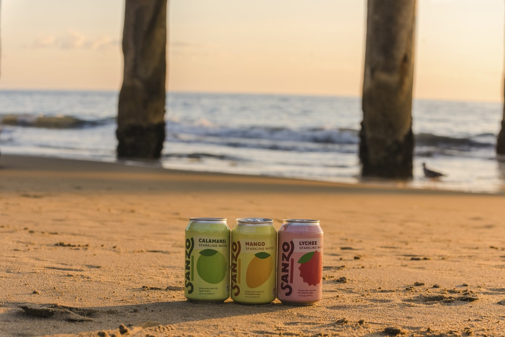 beverage cans at beach