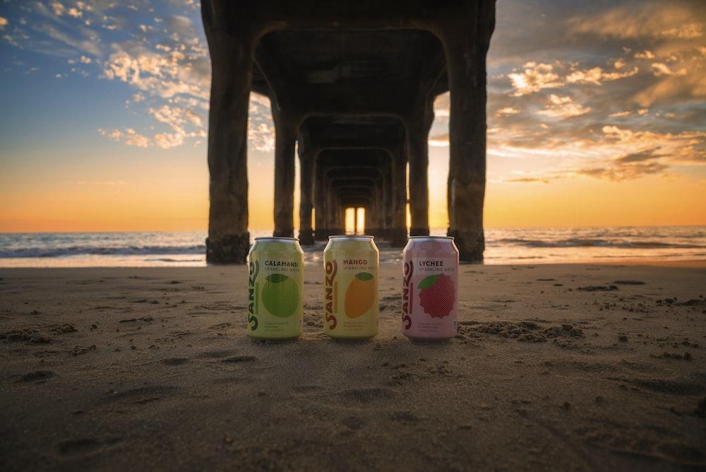 beverage cans under dock at beach