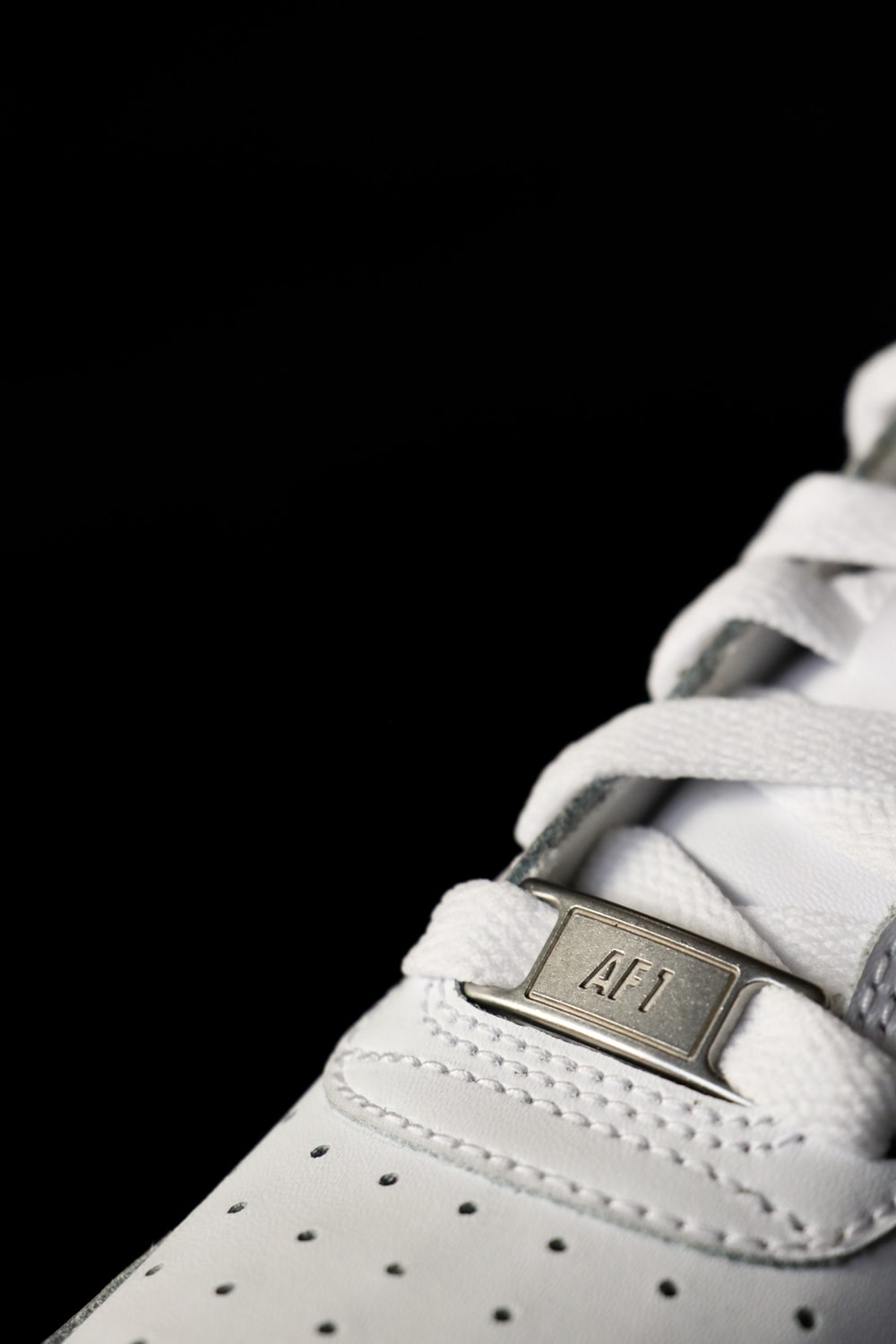 close-up photo of white low-top sneakers