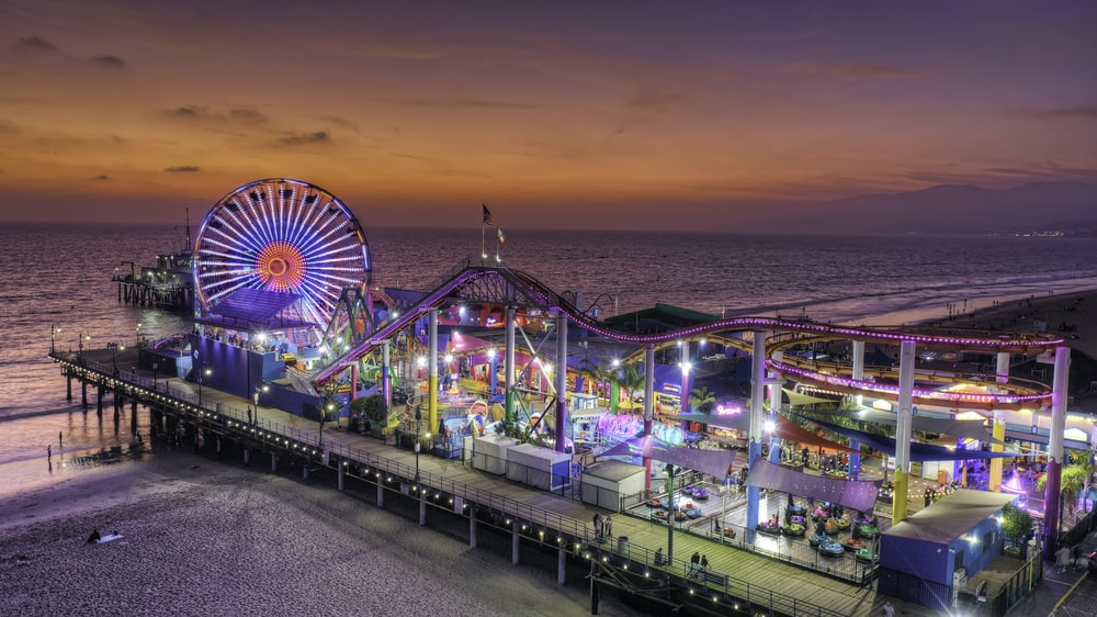 amusement park on dock during golden hour