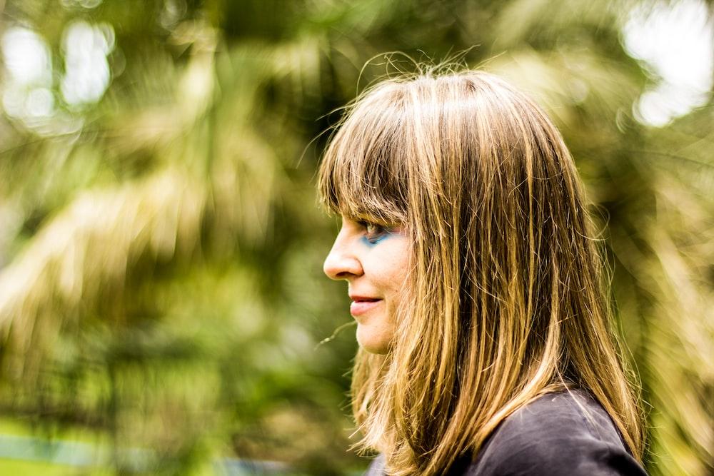 woman with blonde hair wearing black shirt