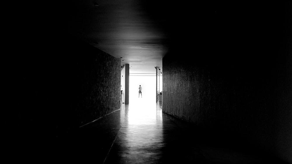grayscale photography of open door