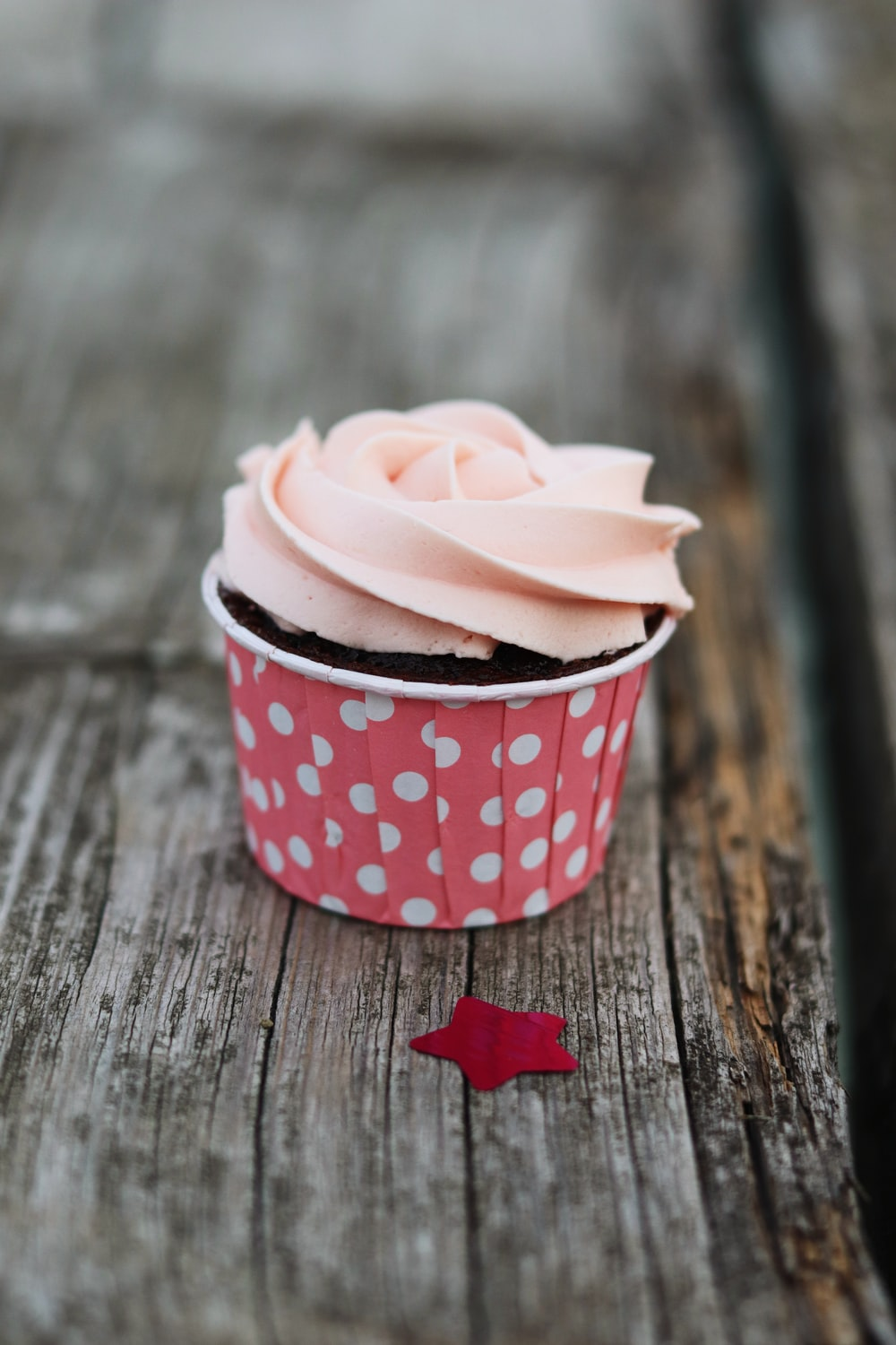 pink and white cup with dessert