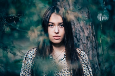 Portrait of a young attractive girl in the woods