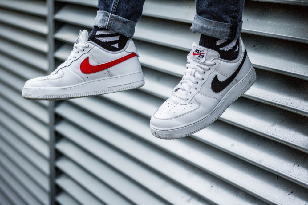 white-and-black Nike Air Force 1 sneakers