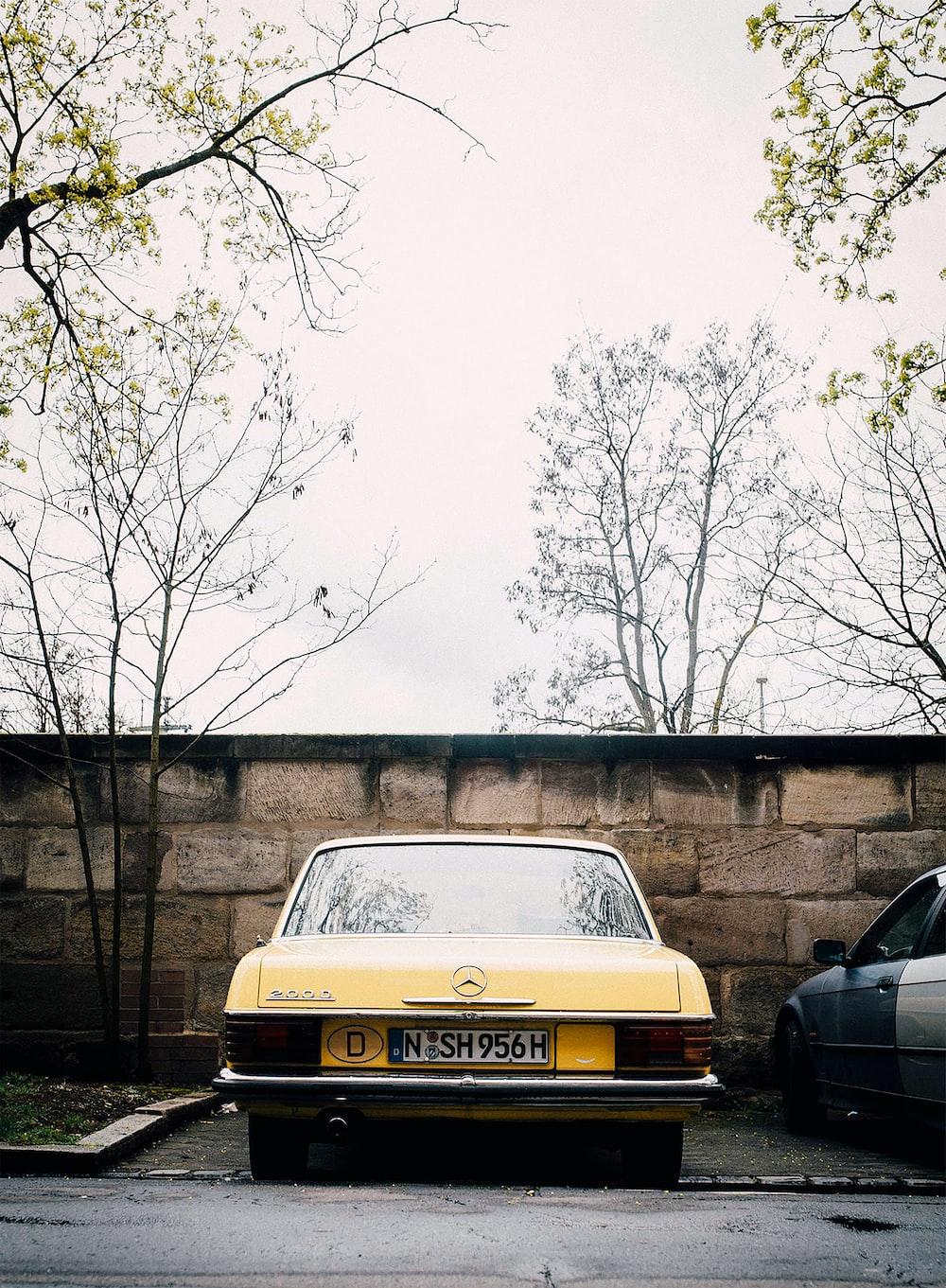 yellow Mercedes-Benz vehicle