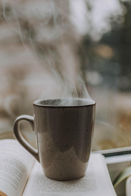 hot beverage on book