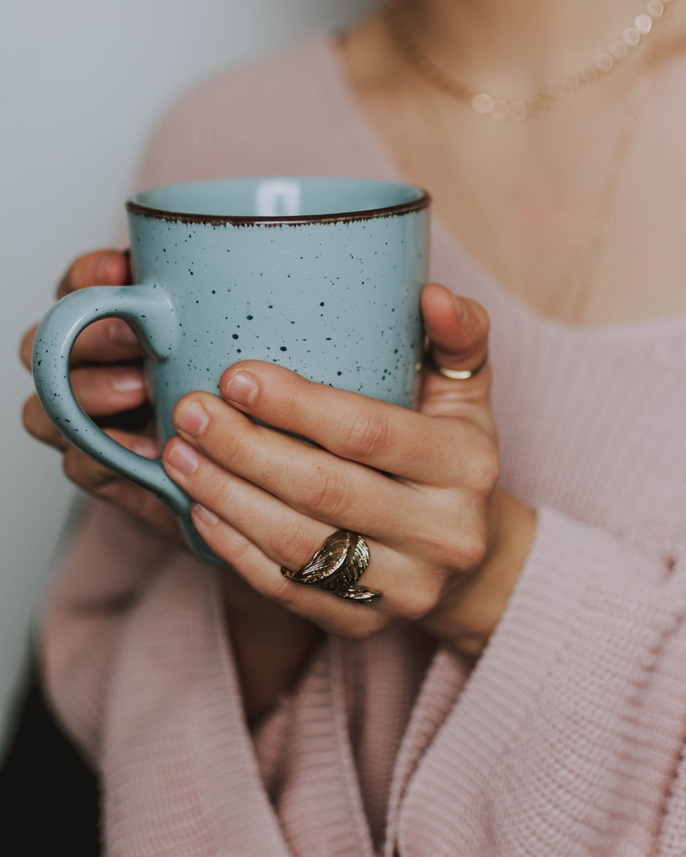 woman holding blue mug