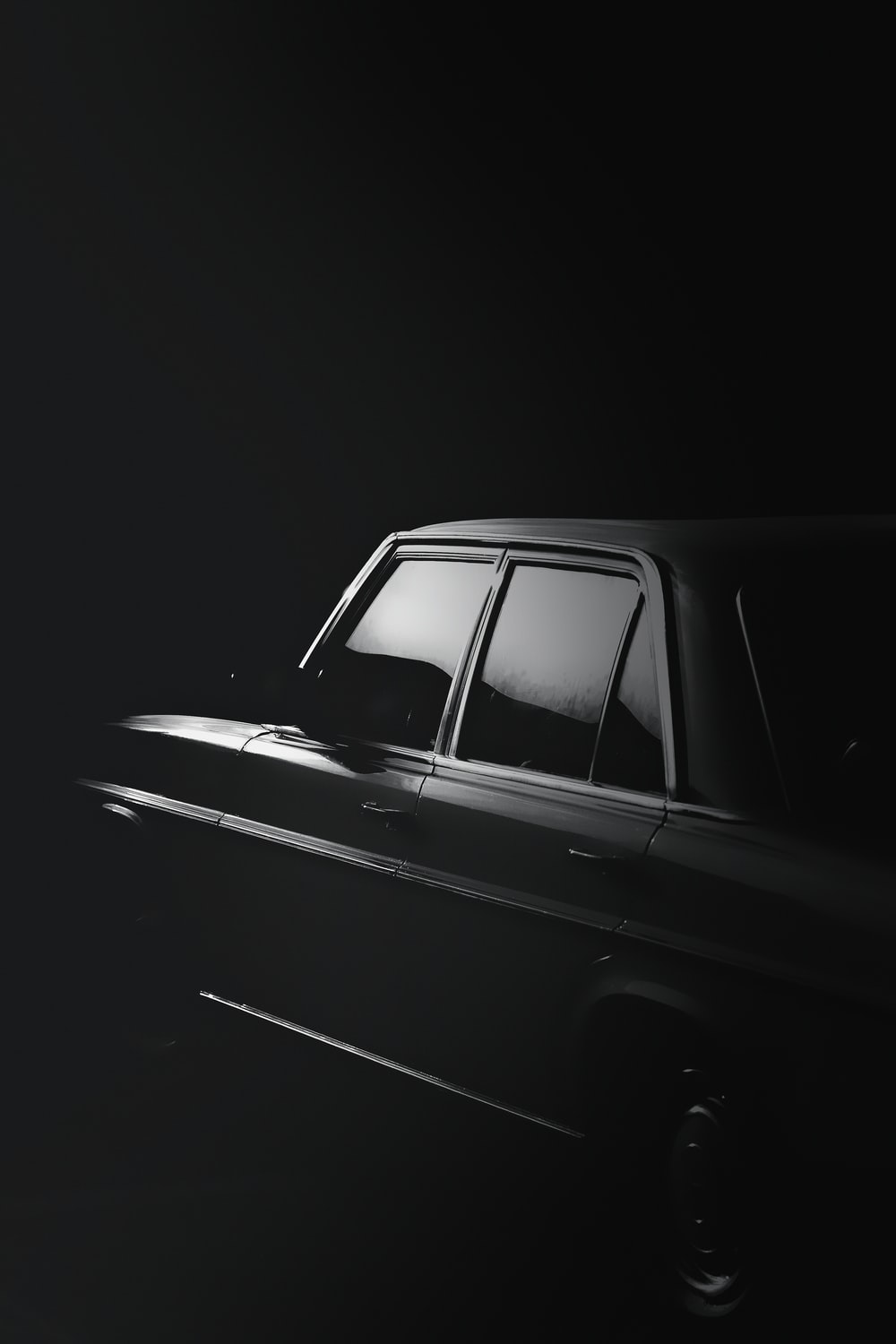 grayscale photo of black sedan